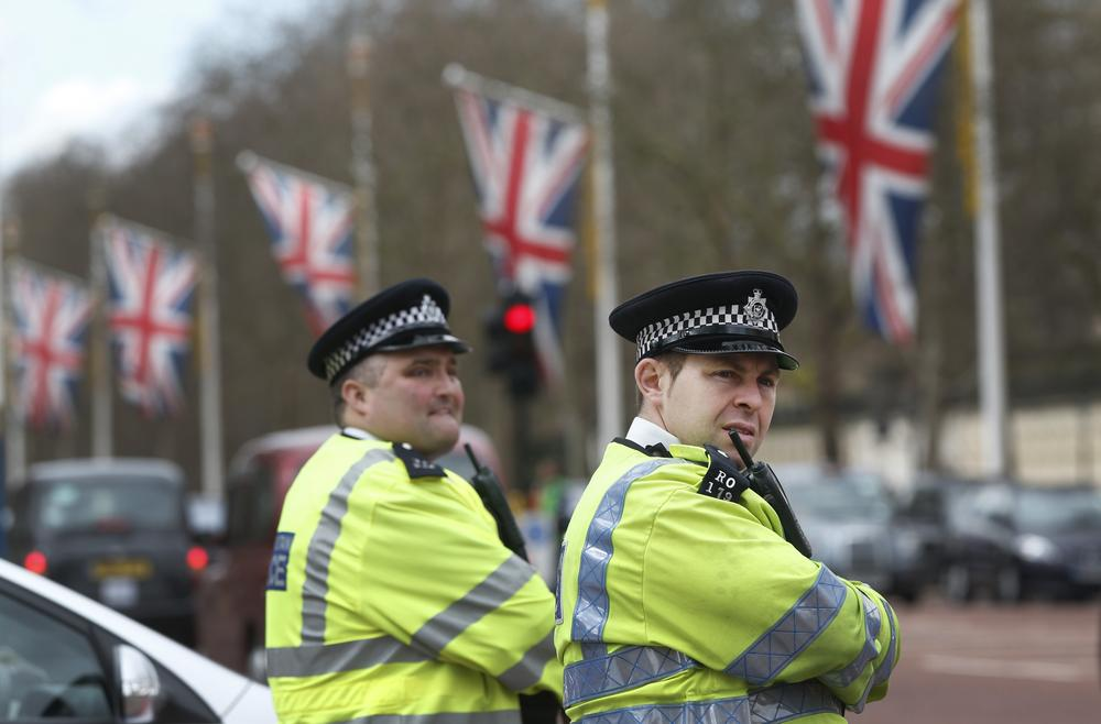British police officers guard the Mall in central London where the London Marathon finish line will be on Sunday. (Lefteris Pitarakis/AP)