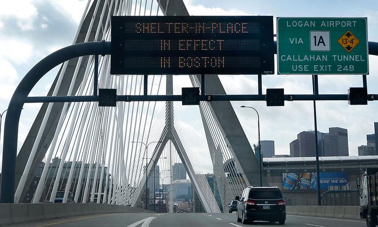 "A message calling for citizens of Boston to ""Shelter in Place"" flashes on a sign on I-93 near the Zakim Bridge in Boston Friday, April 18, 2013. The Boston area was all but paralyzed as a manhunt continued for Dzhokhar Tsarnaev, one of the two suspects in the Boston Marathon bombing. (AP Photo/Elise Amendola)"
