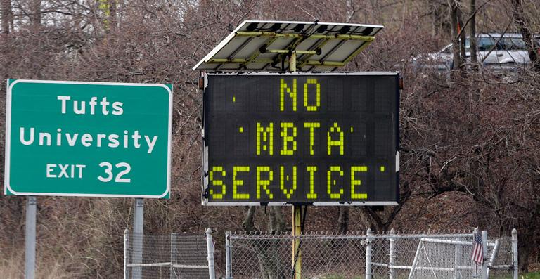 A sign along I-93 in Medford, Mass. announces no MBTA service Friday, April 19, 2013. (AP Photo/Elise Amendola)