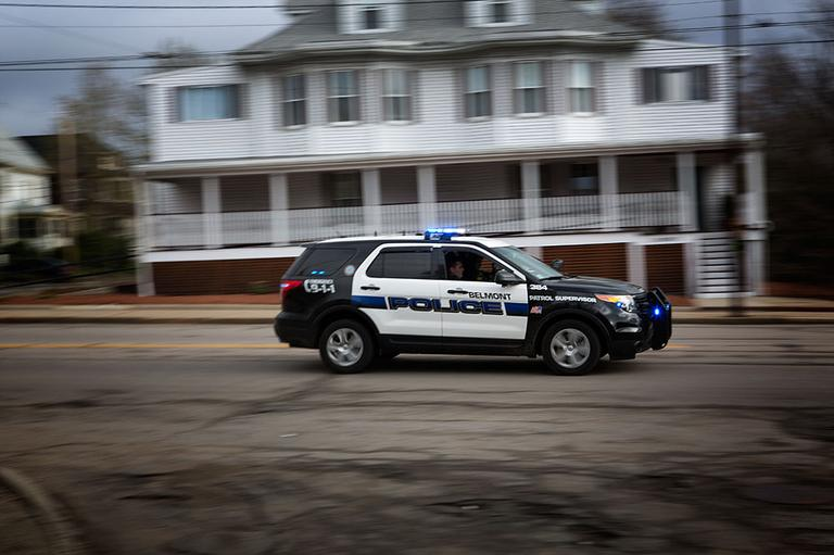Belmont Police racing down Belmont Street on the Watertown line. Friday April 19, 2013. (Jesse Costa/WBUR)