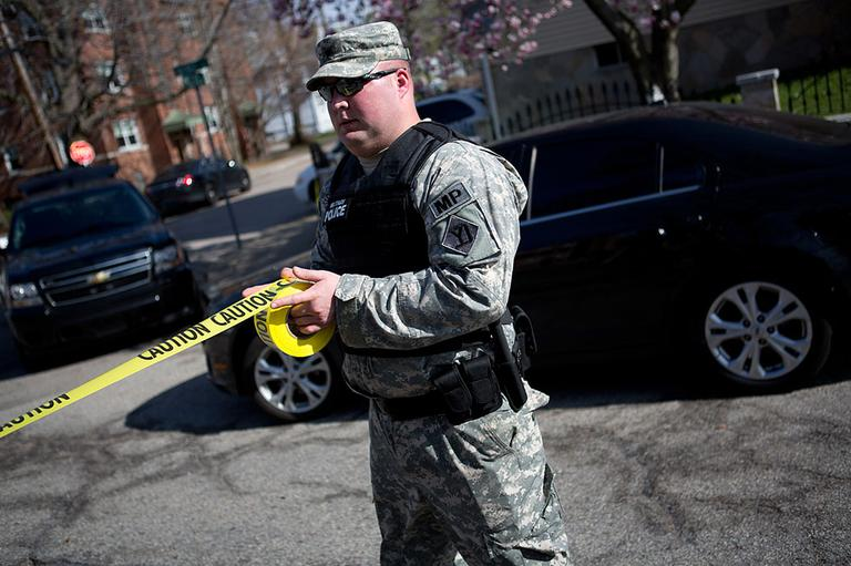 National Guard set up caution tape across Nichols Ave. Friday April 19, 2013. (Jesse Costa/WBUR)