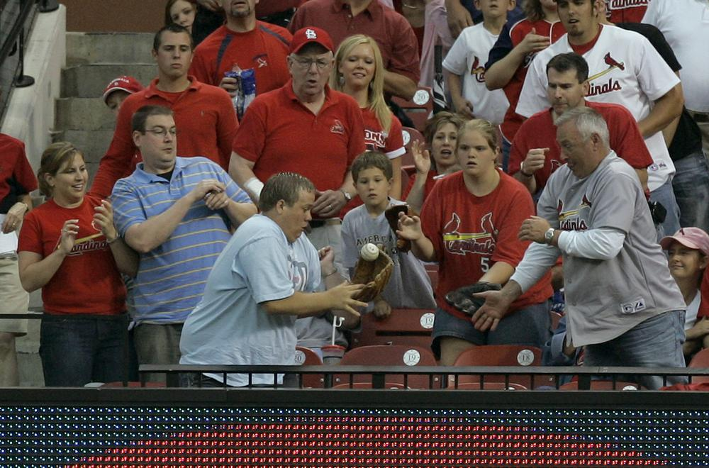 Fans who show up to the ballpark have a chance to get in on the action. (Jeff Roberson/AP)