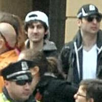 """FBI released this image early Friday, April 19, 2013, showing """"Suspect 1"""" in the white cap and """"Suspect 2"""" in the black cap, walking through the crowd in Boston on Monday, April 15, 2013, before the explosions at the Boston Marathon. (FBI/AP)"""