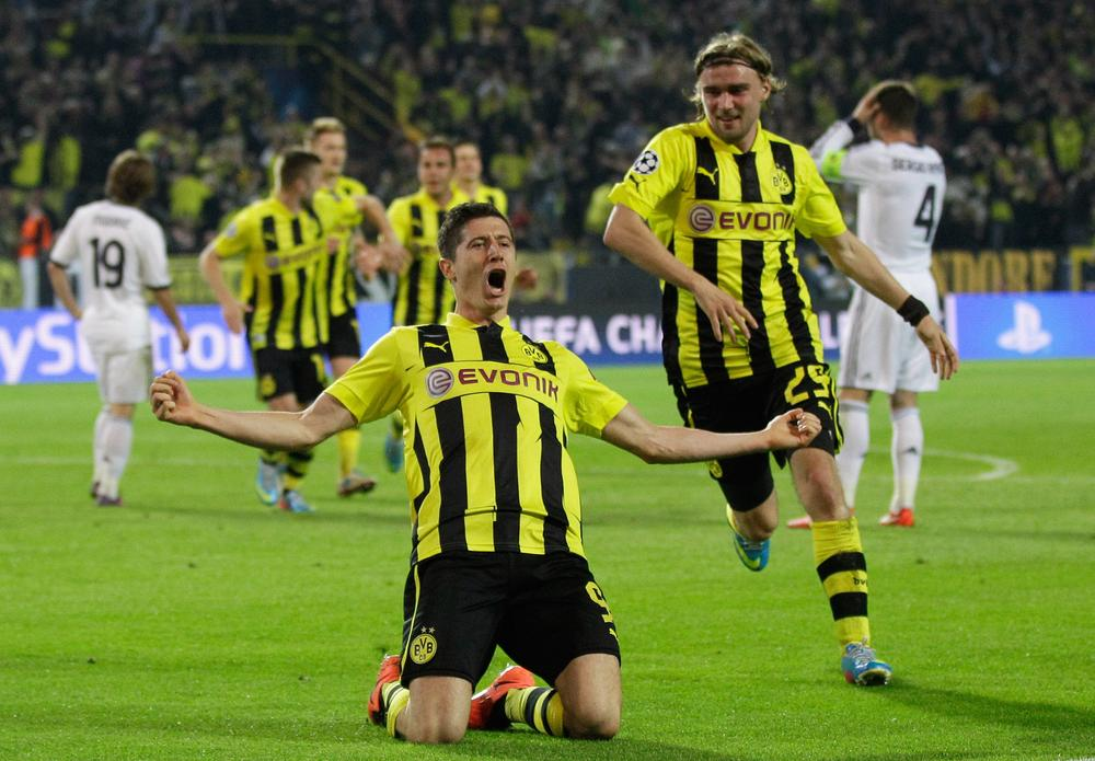 Robert Lewandowski celebrates after scoring one of his four goals during Borussia Dortmund's 4-1 victory over Real Madrid on Wednesday. (Frank Augstein/AP)