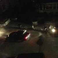 Watertown resident Andrew Kitzenberg took this photo from his window at 12:48 a.m. on Friday. Authorities say the Tsarnaev brothers fired on Watertown officers from behind the Mercedes SUV they stole in a carjacking. (Andrew Kitzenberg/getonhand.com)