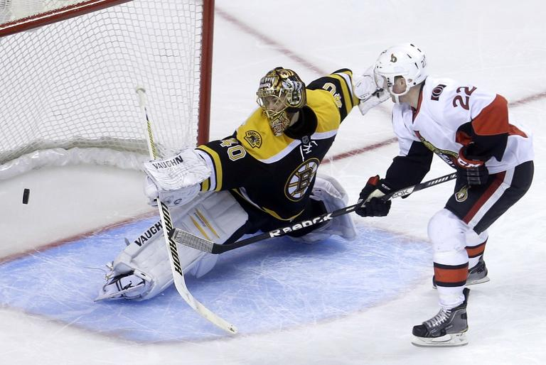 Goalie Tuukka Rask makes a save in April. (Steven Senne/AP)
