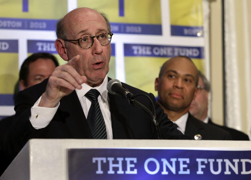 Kenneth Feinberg, an attorney who managed the 9/11 Victim Compensation Fund, speaks at a news conference in Boston on April 23, 2013, as Massachusetts Gov. Deval Patrick listens at right. Feinberg will design and be administrator of a new fund to help people affected by the Boston Marathon bombing. (Elise Amendola/AP)