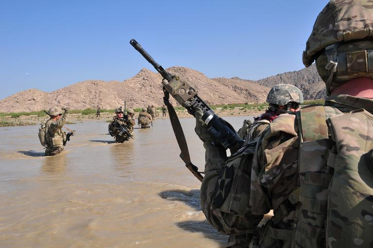 U.S. Soldiers with Charlie Company, 1st Battalion, 38th Infantry Regiment, 4th Brigade Combat Team, 2nd Infantry Division cross the Tarnak river in the Panjwai district of Kandahar province, Afghanistan, April 10, 2013, on a two-day mission to clear the area of explosives caches. (Sgt. Kimberly Hackbarth/U.S. Army via AP)