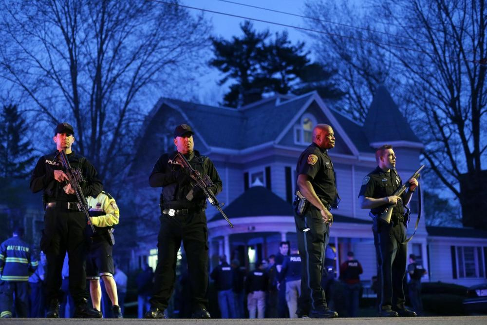 Police officers guarded the entrance to Franklin street where there was an active crime scene in the search for the suspect in the Boston Marathon bombings, Friday, April 19, 2013, in Watertown, Mass. (AP Photo/Matt Rourke)