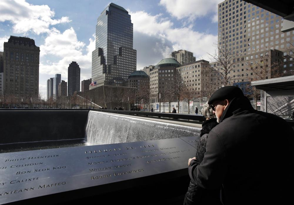 An observer looks at the names engraved in memory of those who died in the terrorist bombing of the World Trade Center, at the National September 11 Memorial and Museum, in New York. (Mark Lennihan/AP)