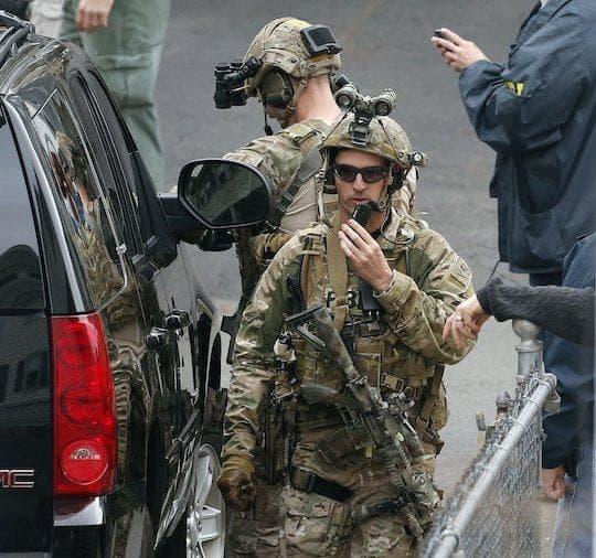 FBI agents in Cambridge. (AP / Michael Dwyer)