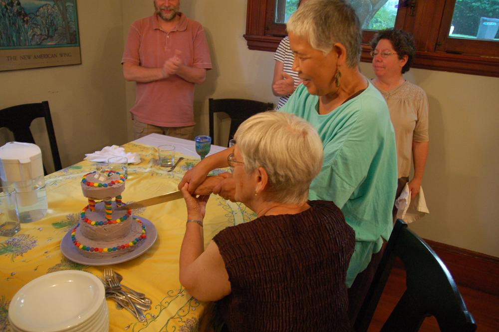 The brides cut the cake. (Courtesy Ned Batchelder)