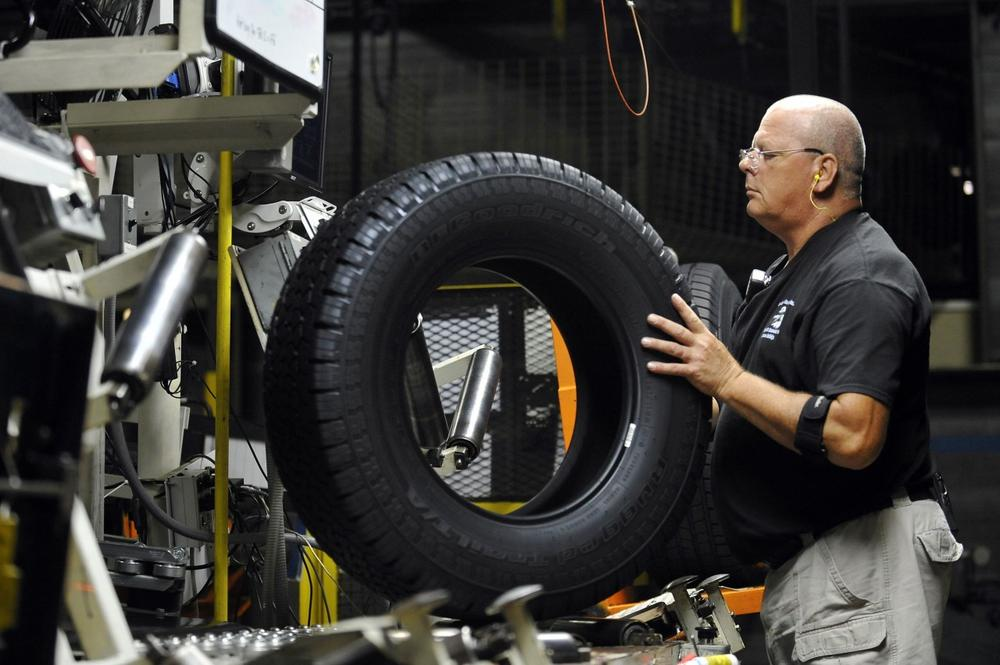 In this Tuesday, July 24, 2012, photo, tire inspector Buddy Rice checks for defects in the tire verification area at a Michelin manufacturing plant in Greenville, S.C. (AP)