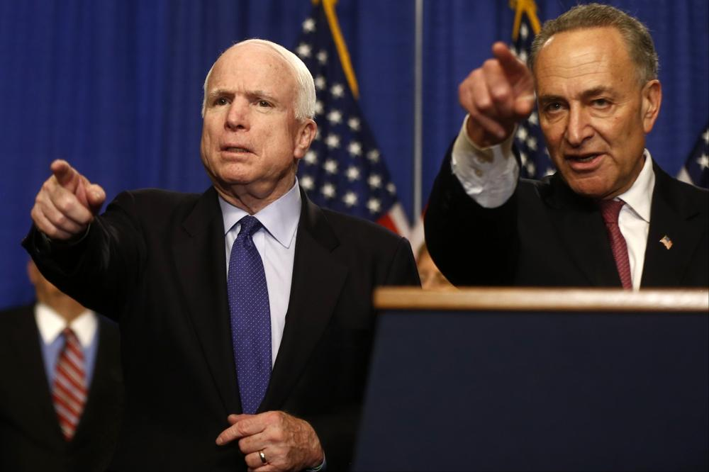 Sen. John McCain, R-Ariz., left, and Sen. Charles Schumer, D-N.Y. take questions during a news conference on immigration reform legislation, Thursday, April 18, 2013, on Capitol Hill in Washington. (AP)