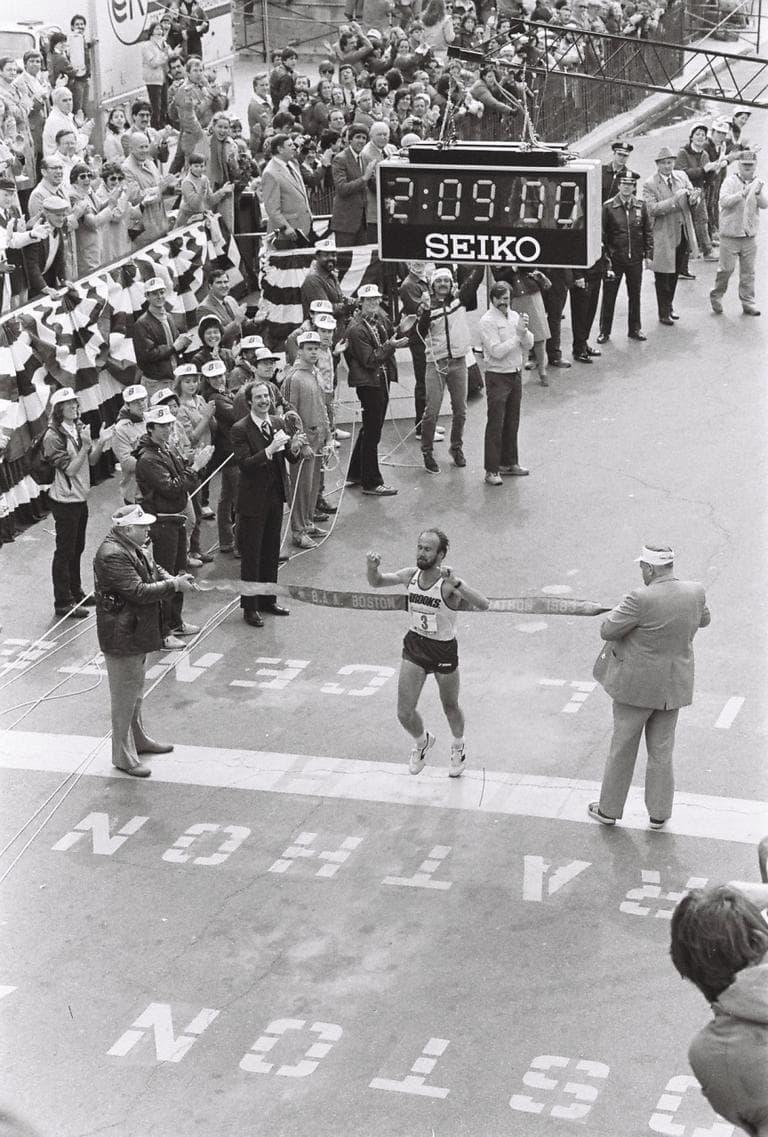 Greg Meyer crosses the finish line of the 1983 Boston Marathon, winning the race. (Jeff Johnson/runmoremiles.com)