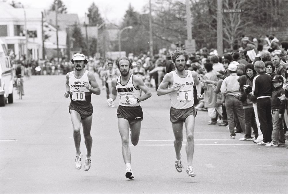 Greg Meyer, middle, runs the 1983 Boston Marathon. At this point in the race, Benji Durden, right, and Paul Cummings, left, are in close competition. (Jeff Johnson/runmoremiles.com)