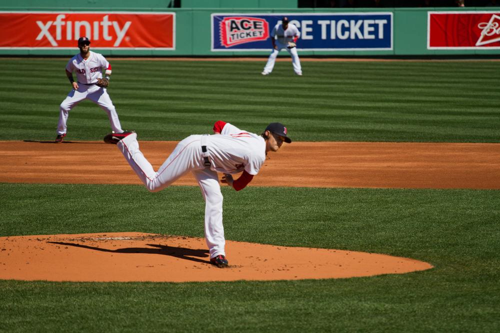 Red Sox pitcher Clay Buchholz throws the first pitch of 2013 in Fenway Park. (Jesse Costa/WBUR)