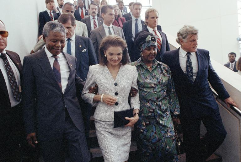 Jacqueline Kennedy Onassis walks with Nelson Mandela and Sen. Edward Kennedy through the JFK Library. (Peter Southwick/AP)