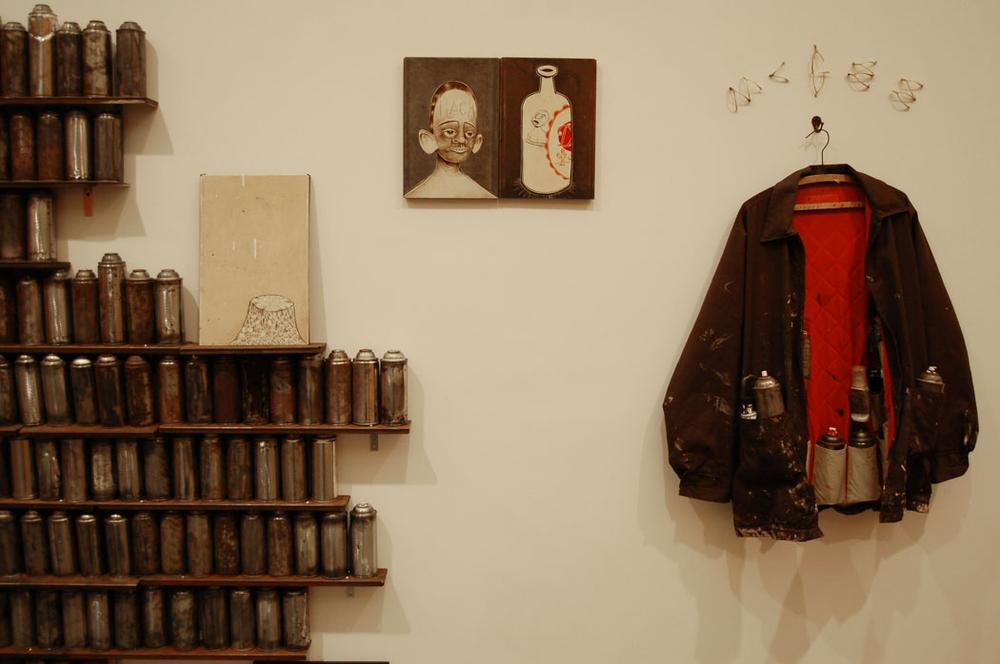 Barry McGee's coat and spraycans. (Greg Cook)