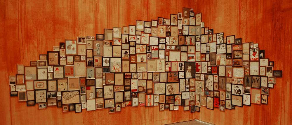 Dense displays of ex-votos that McGee saw at Brazilian church in 1993 inspired his cluster installations, like this one from 1998. (Greg Cook)