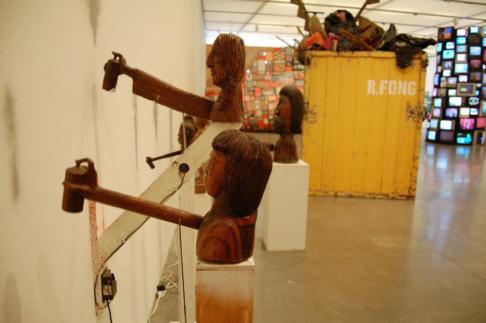 Barry McGee's animatronic wood and styrofoam taggers from 2004/2012. (Greg Cook)