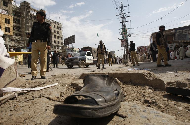 Pakistani police officers cordon off the site of attack in Peshawar, Pakistan on Monday. A suicide bomber targeting policemen killed at least 6 people in northwestern Pakistan on Monday in the latest attack ahead of next month's parliamentary election, police said. (AP)