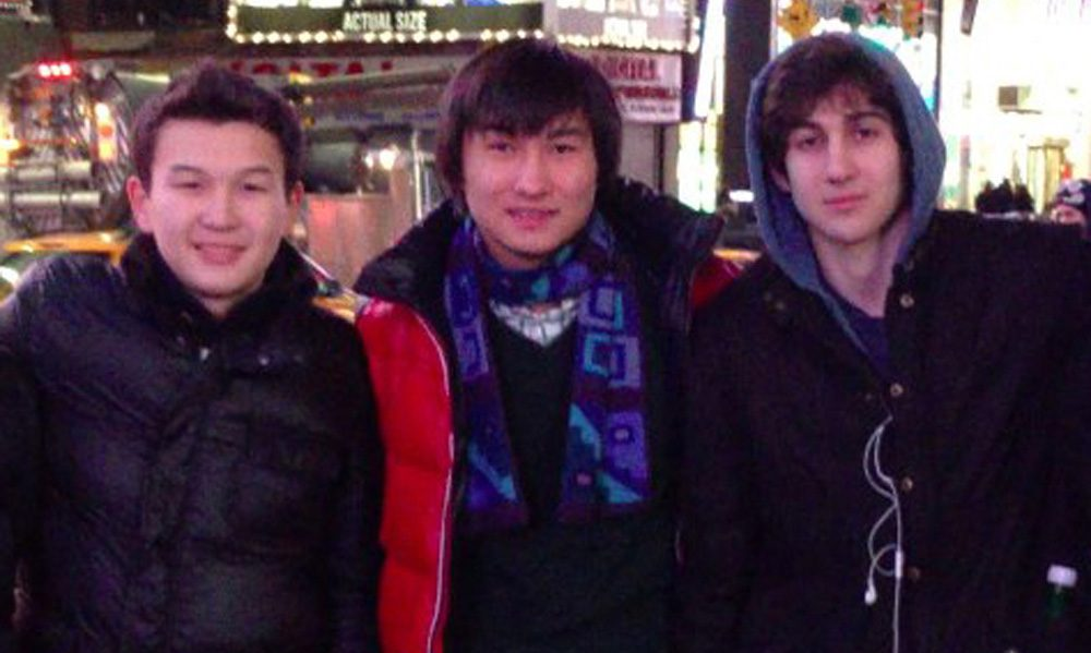 This undated photo added on April 18, 2013, to the VK page of Dias Kadyrbayev shows, from left, Azamat Tazhayakov and Kadyrbayev with Boston Marathon bombing suspect Dzhokhar Tsarnaev in Times Square in New York. (VK/AP)