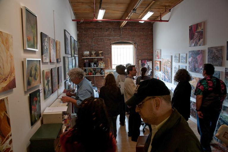 Visitors in a Somerville artist's studio during SOS 2012. (Aram Comjean)