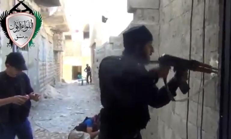 In this image taken from video obtained from the Ugarit News, which has been authenticated based on its contents and other AP reporting, Syrian rebels clash with government forces in Damascus, Syria, Friday, May 3, 2013. (Ugarit News via AP)