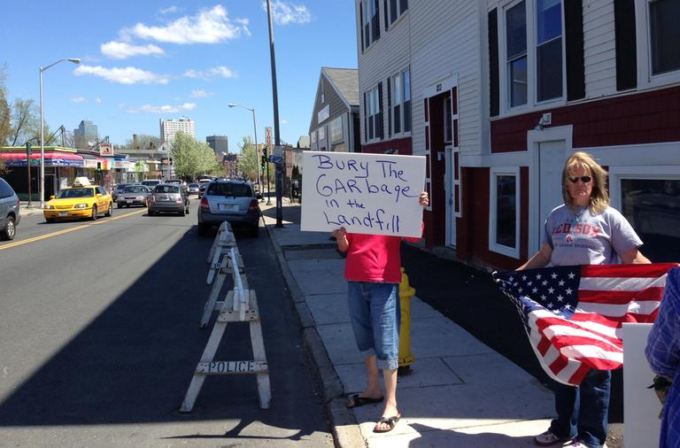 On Saturday,  a protester demonstrates outside the Worcester funeral home that is holding Tamerlan Tsarnaev's body. (Deborah Becker/WBUR)