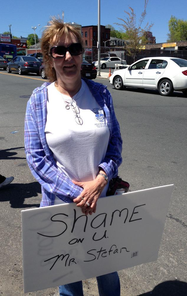 Pat Hildreth of New Hampshire protests outside the funeral home that has Tamerlan Tsarnaev's body on Saturday. (Deborah Becker/WBUR)