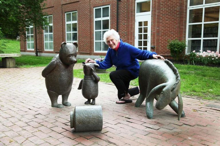 Sculptor Nancy Schön poses with Eeyore, Winnie the Pooh and newly added Piglet outside the Newton Free Library. (Courtesy of Jacki Schon)