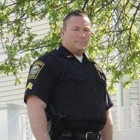 """Watertown Police Sgt. John MacLellan and his """"tree of life."""" (Jonathan Peck/WBUR)"""