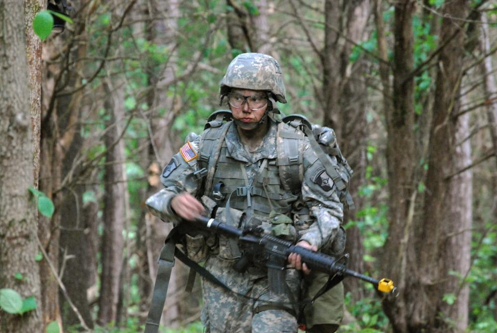 Capt. Sara Rodriguez of the 101st Airborne Division walks through the woods during the expert field medical badge testing at Fort Campbell, Ky. (AP)