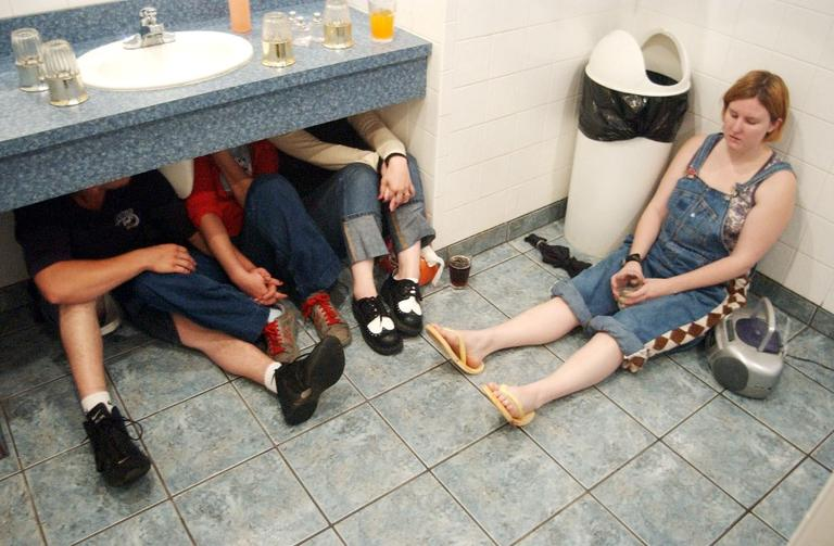 Adam Scudder, Trisha Milittle, Tamra Jones and Bridget Kline, from left, take shelter at Pelican's Restaurant in northern Oklahoma City as a tornado passes nearby Friday night, May 9, 2003. (Andrew Laker/AP)