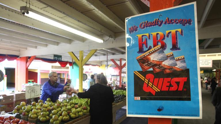In this 2010 photo, a sign announcing the acceptance of electronic Benefit Transfer cards is seen at a farmers market in Roseville, Calif. (Rich Pedroncelli/AP)