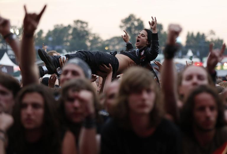 A metal fan crowd surfs in a mosh pit during the heavy metal festival Wacken Open Air in Germany. (Philipp Guelland, DAPD/AP)