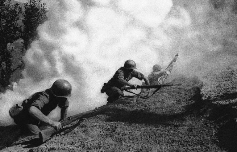Rangers serving with the Fifth United States Army advance up a hillside in Italy under cover of smoke, with the object of clearing the Germans from the hills, in this undated photo. (AP)