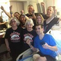 Marc Fucarile and his family celebrates his move to rehab. (Martha Bebinger/WBUR)