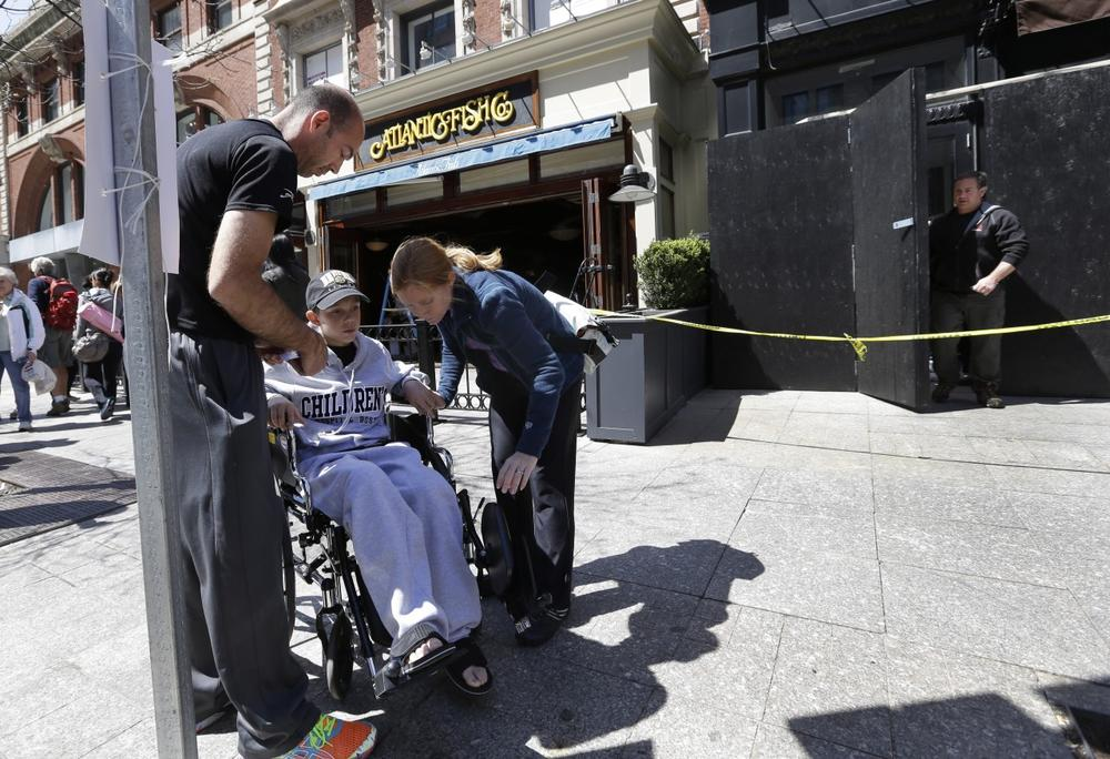 Aaron Hern, 11, of Martinez, Calif. visits the place where he was injured during the second bombing at the Boston Marathon finish line, Thursday, April 25, 2013. (Elise Amendola/AP)