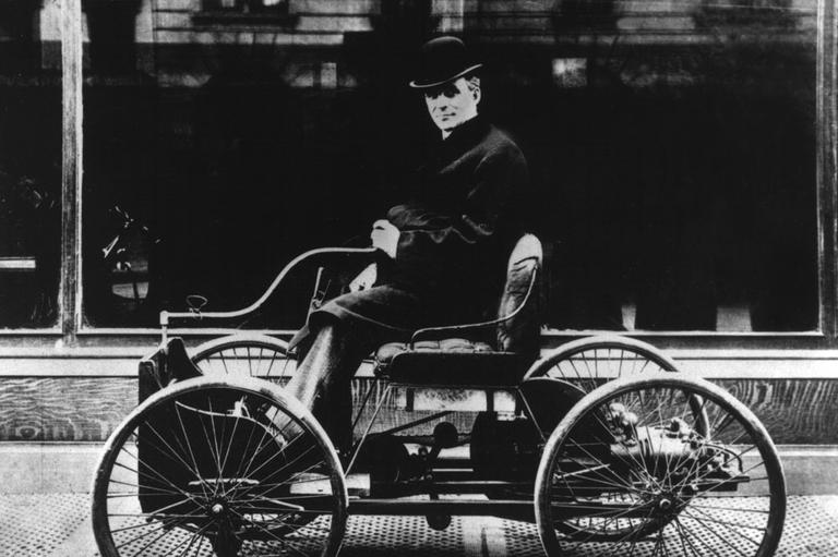 Henry Ford sits at the tiller of his first automobile, the Quadricycle, in front of the John Wanamaker salesroom on Broadway between 49th and 50th Streets in New York City in 1904. (Ford Motor Company/AP)