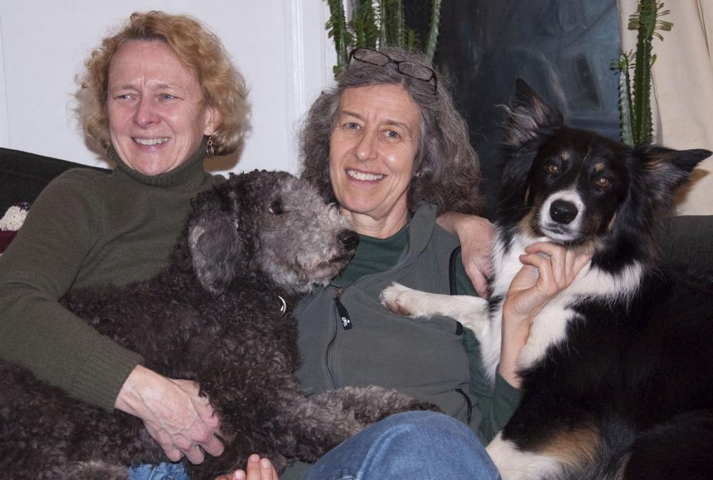 Lee Swislow (right) and her wife Denise at home with their border collie Strider, and their poodle, Bishop. (Courtesy)