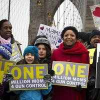 Demonstrators march over the Brooklyn bridge towards downtown Manhattan during the One Million Moms for Gun Control Rally, Jan. 21, 2012, in New York. (John Minchillo/AP)