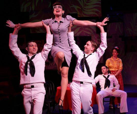 """Aimee Doherty and the cast of the Lyric Stage Company's """"On the Town."""" (Mark S. Howard)"""