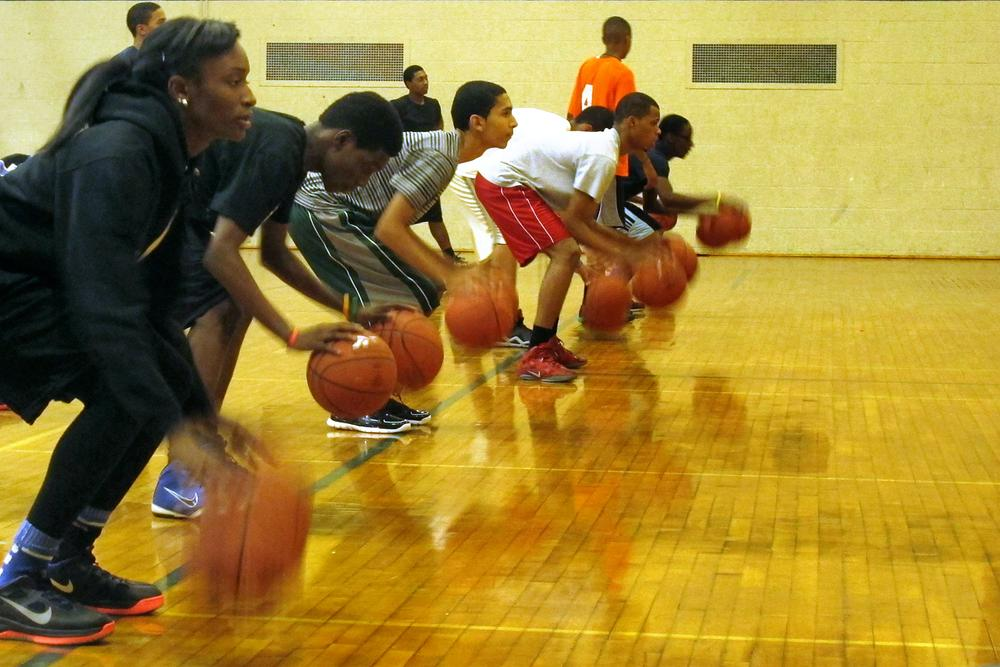 Players dribble during a basketball skills clinic sponsored by the BSA in November. (Karen Given/WBUR)