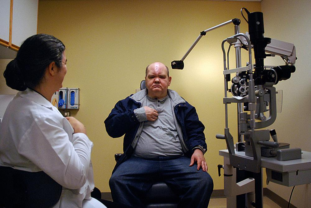 At a post-op exam, Dr. Rowe checks to make sure Kevin is healing properly. (George Hicks/WBUR)