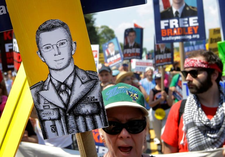 Protesters march during a rally in support of Army Pfc. Bradley Manning outside of Fort Meade, Md., Saturday, June 1, 2013. (Patrick Semansky/AP)