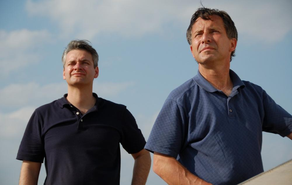 This undated photo provided by The Discovery Channel shows Carl Young, left, and Tim Samaras watching the sky. (Discovery Channel via AP)