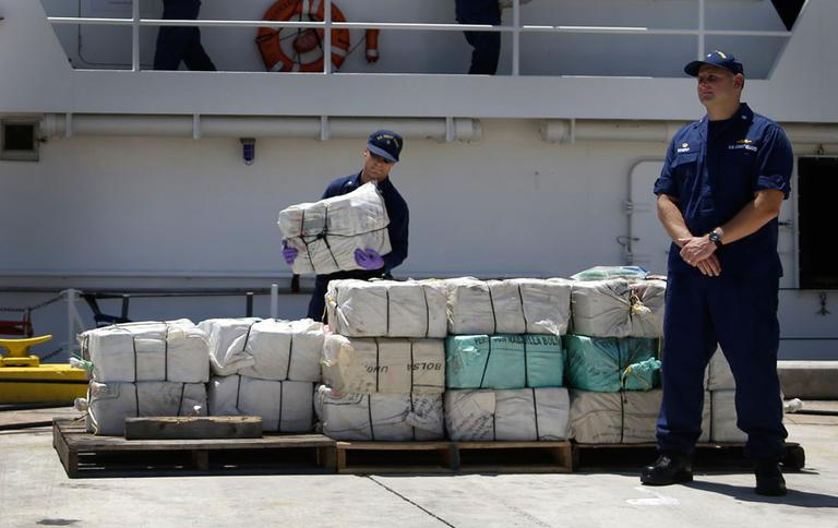 U.S. Coast Guard crew members offload bales of cocaine seized in the Caribbean, Friday, April 26, 2013 (AP)