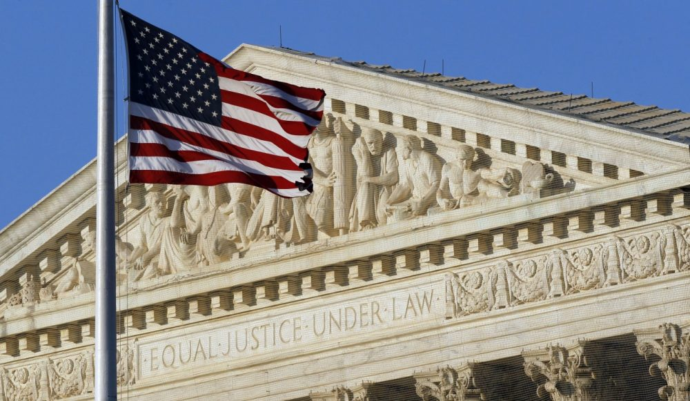 An American flag flies in front of the Supreme Court in Washington. (Alex Brandon/AP)